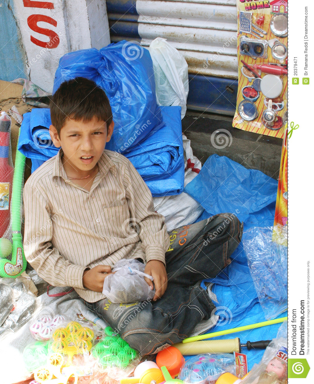 Toys For Young : Young boy selling toys on roadside editorial photo image