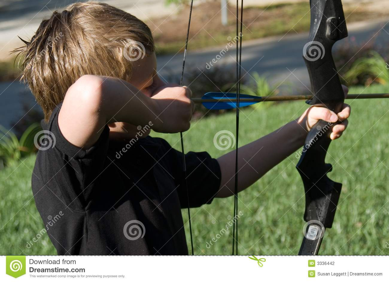 Young Boy Shooting Arrow