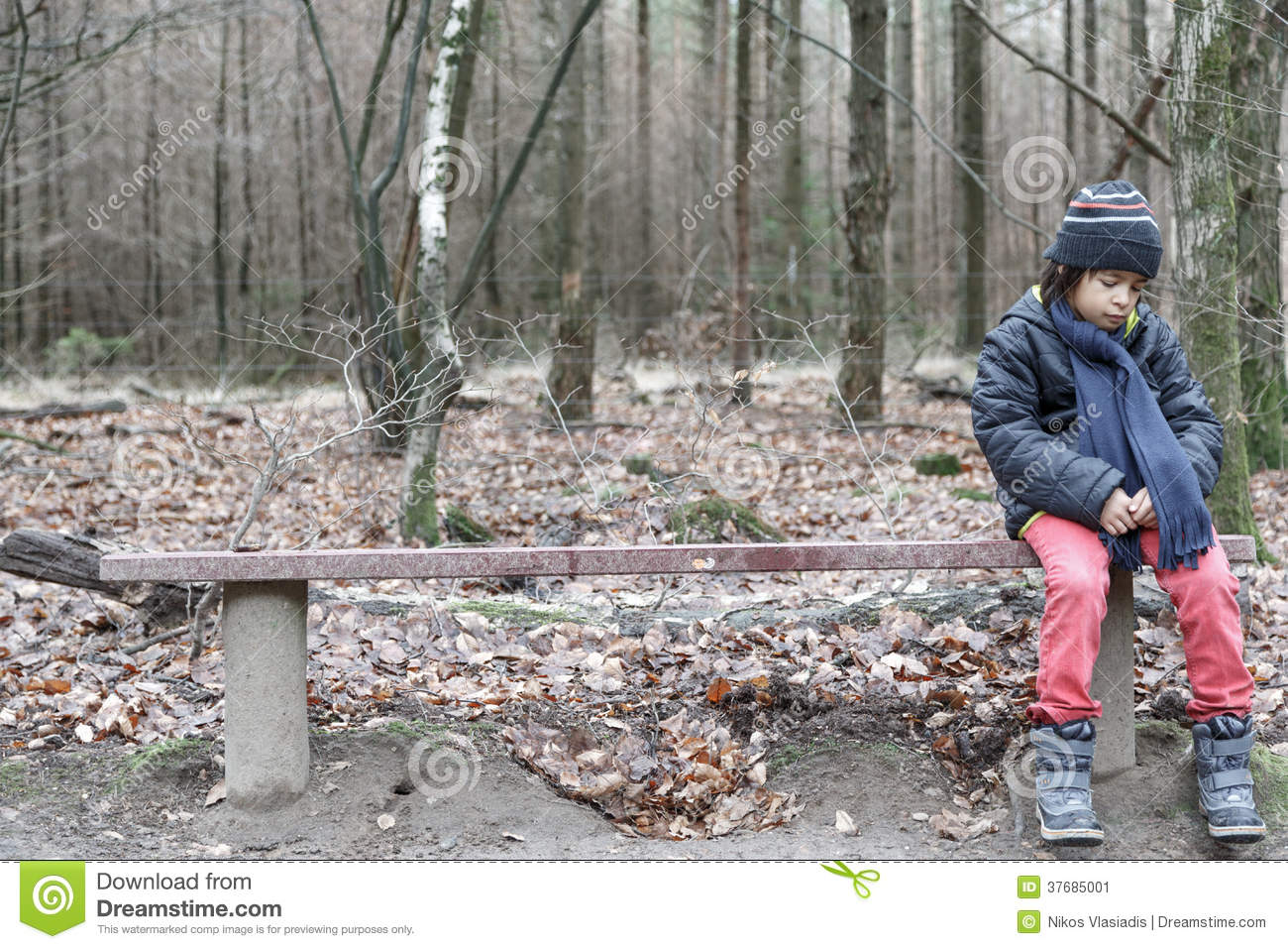 Young Boy Sitting Alone On A Rustic Bench Stock Image