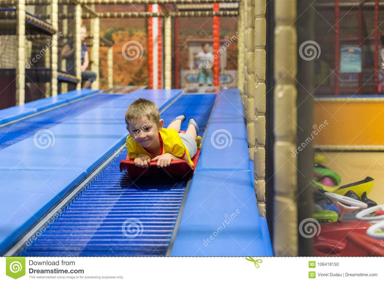 Young boy on sled slide