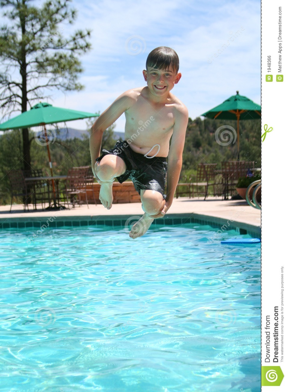 Download Young Boy Smiling And Jumping Into A Swimming Pool Stock Photo - Image of smile, relaxing: 1948366