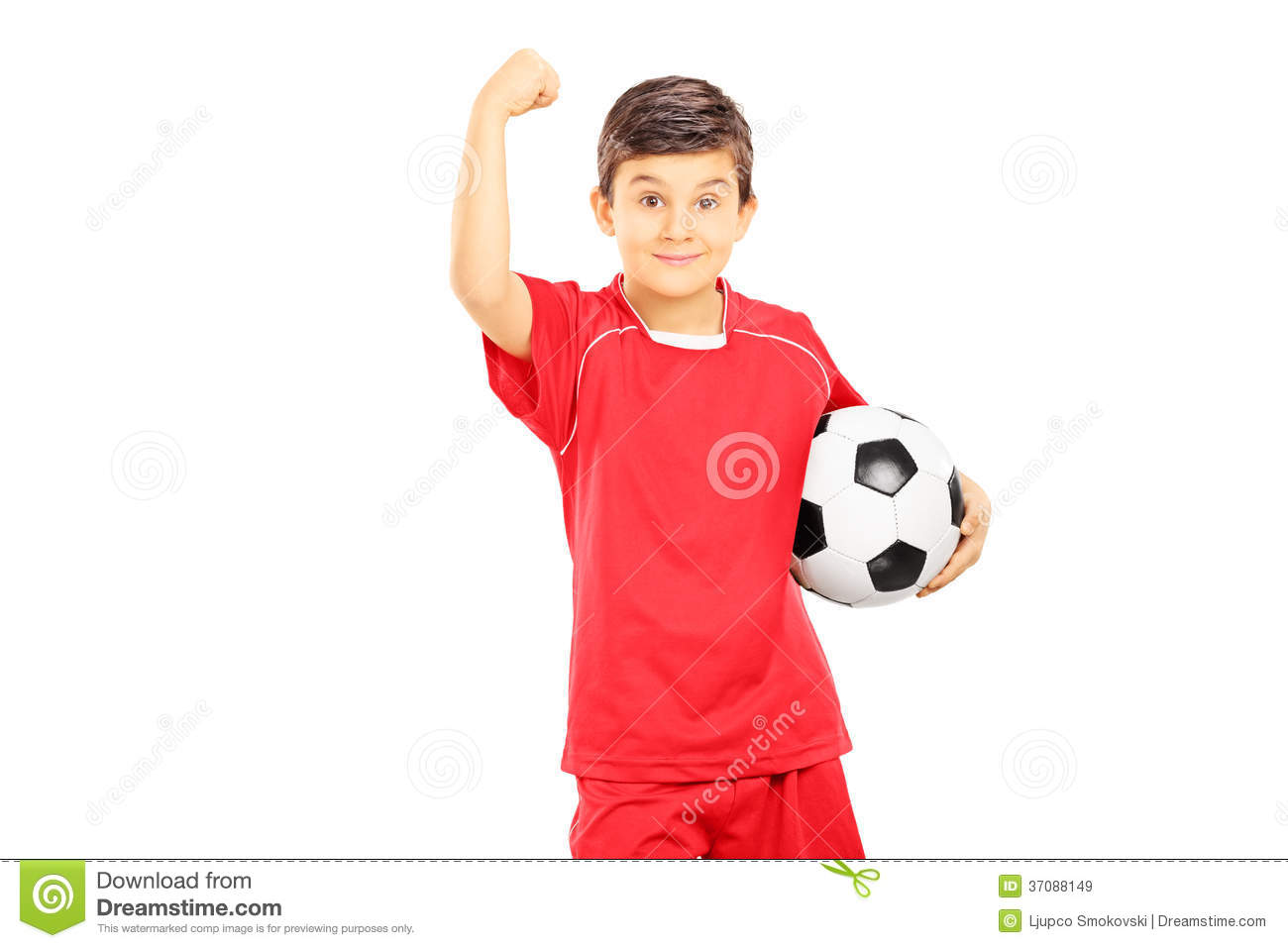 young boy in sportswear holding soccer ball and gesturing with h royalty free stock images