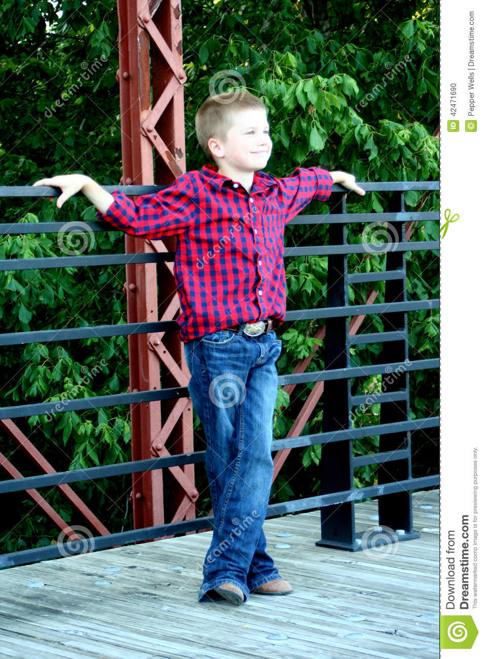 Young Boy Standing On A Bridge Stock Photo Image 42471690