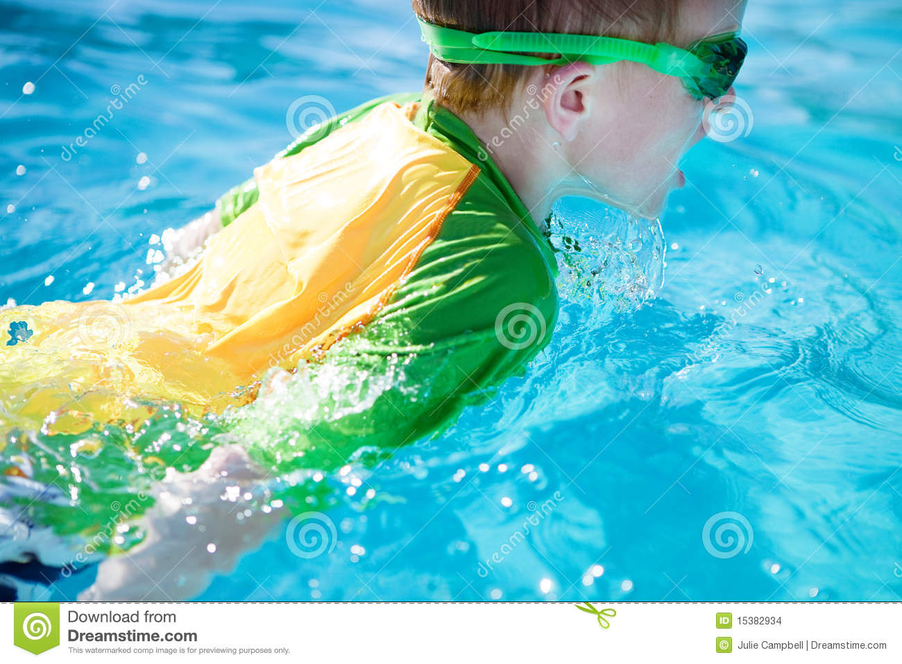 Young boy swimming in the pool stock images image 15382934 for Chicken in swimming pool