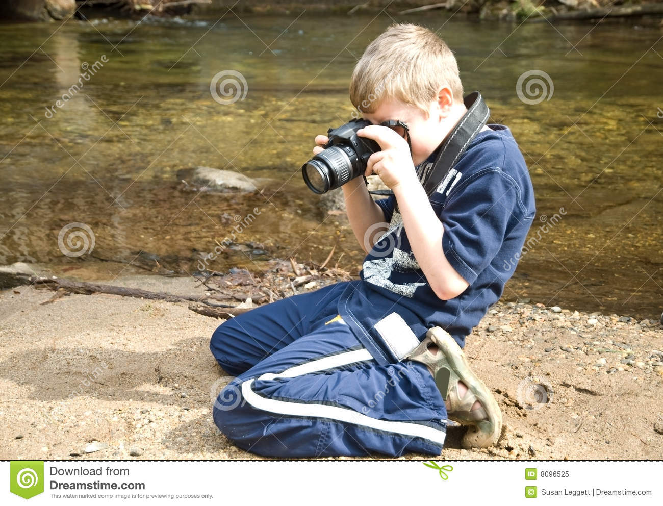 Young Boy Taking Photo/Camera