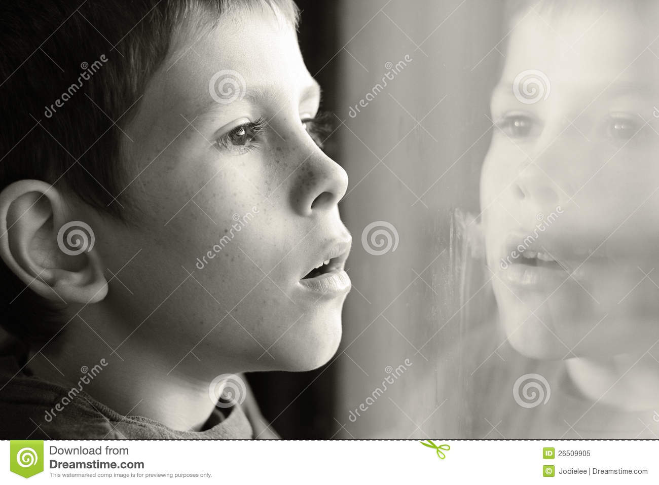Young boy in thought with window reflection