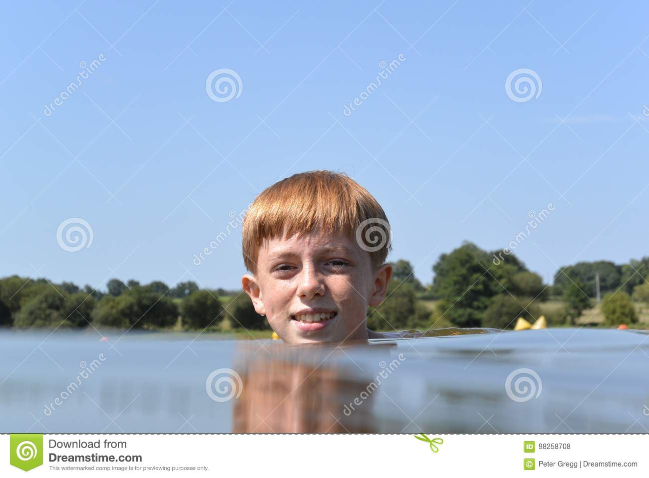 Young boy treading water