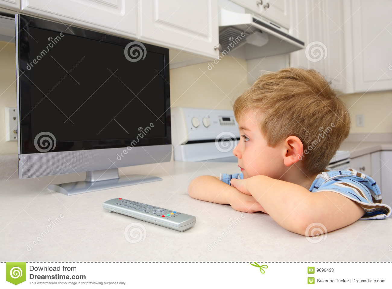 Young Boy Watching Tv In A Kitchen Stock Photo Image Of