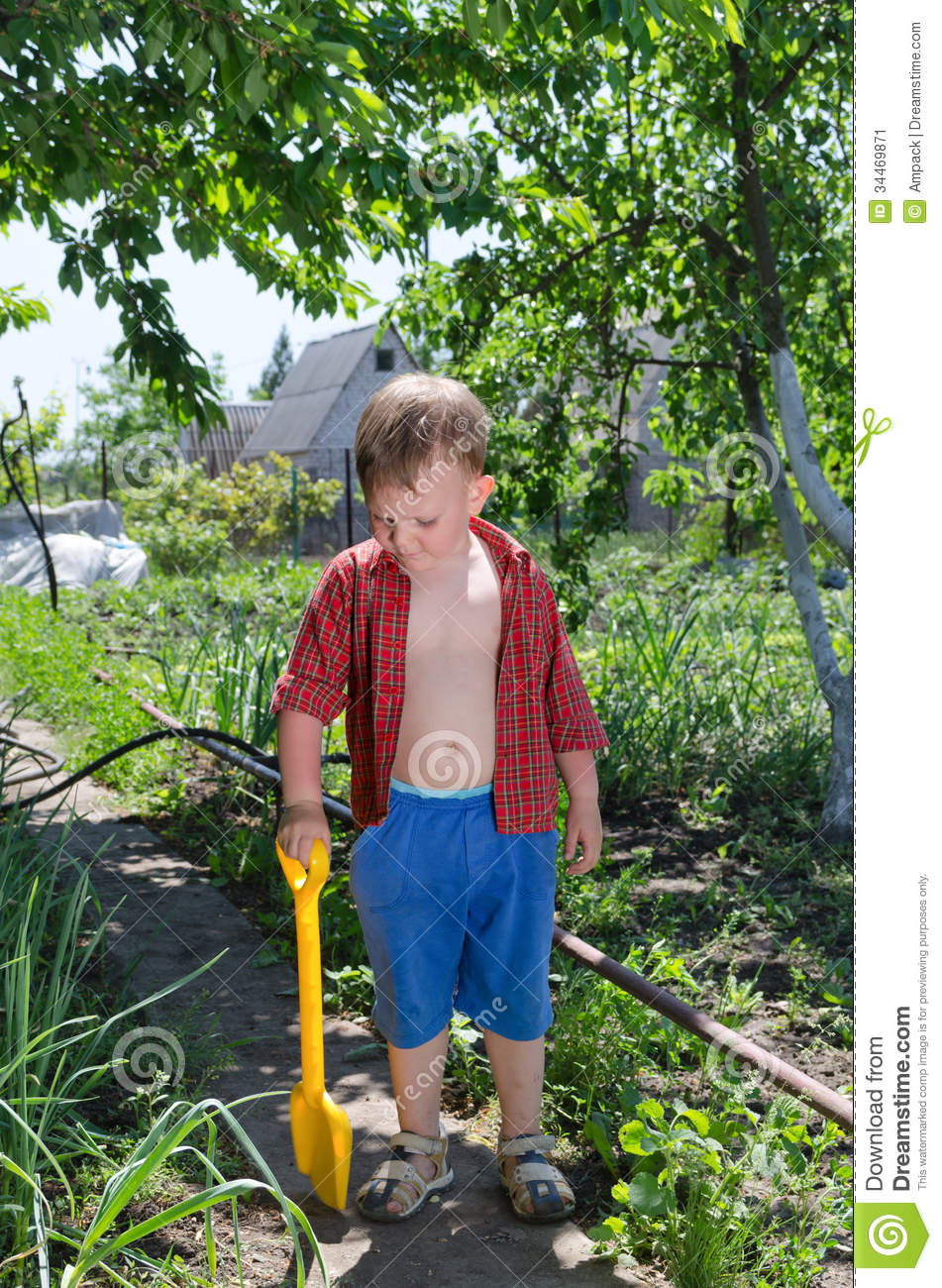 young female gardener working in plant nursery stock photo