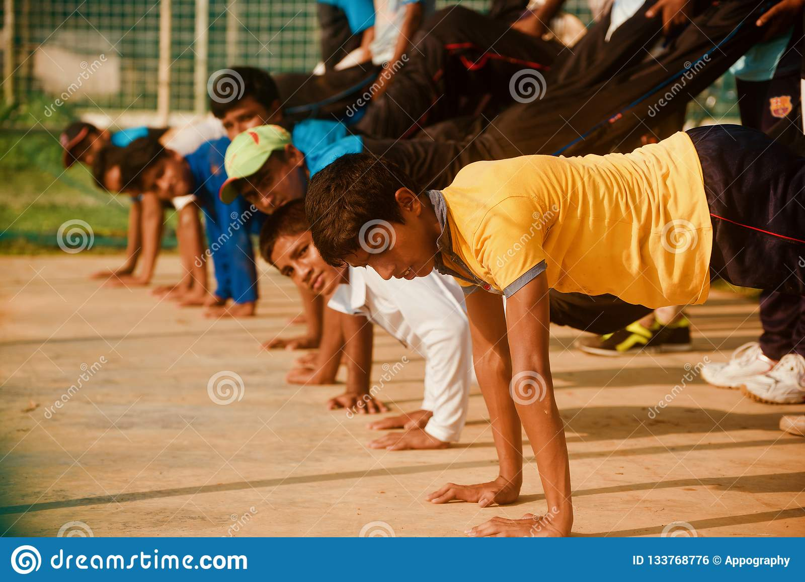 Young boys doing exercise in a group unique photo