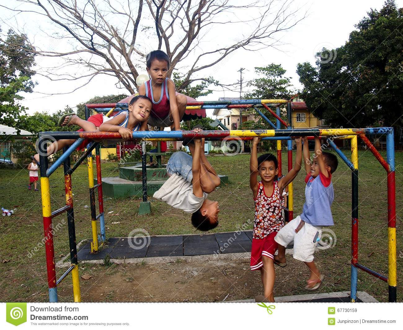 Young boys and girls playing at a playground in Antipolo City, Philippines