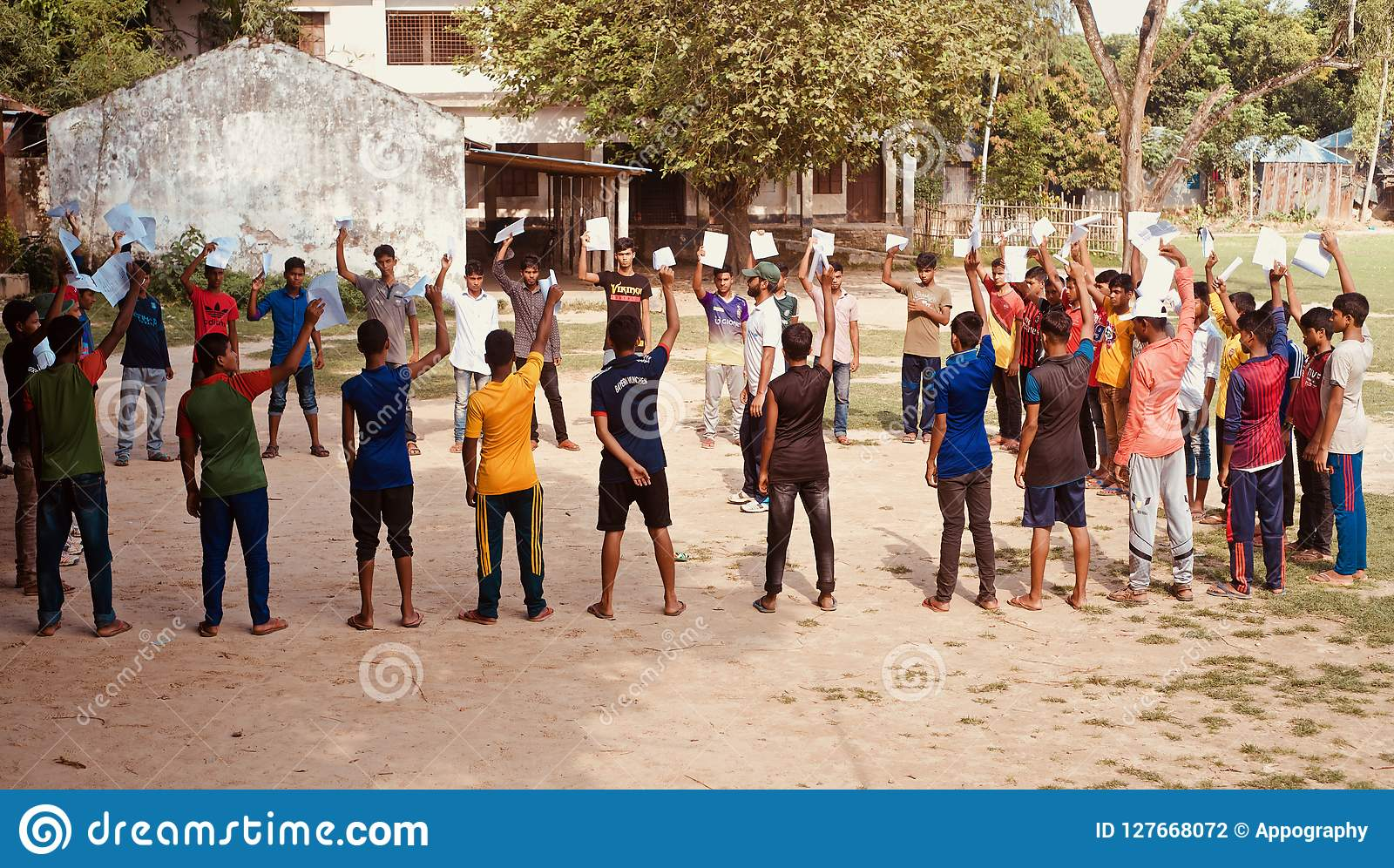 Young boys raising hands standing in a place unique photo