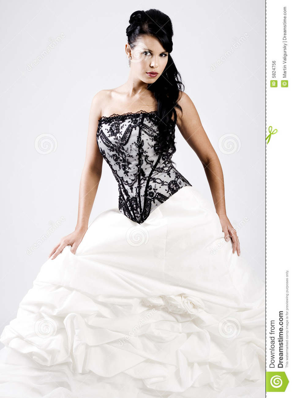 Young bride in black and white wedding dress royalty free for Wedding dresses for young brides