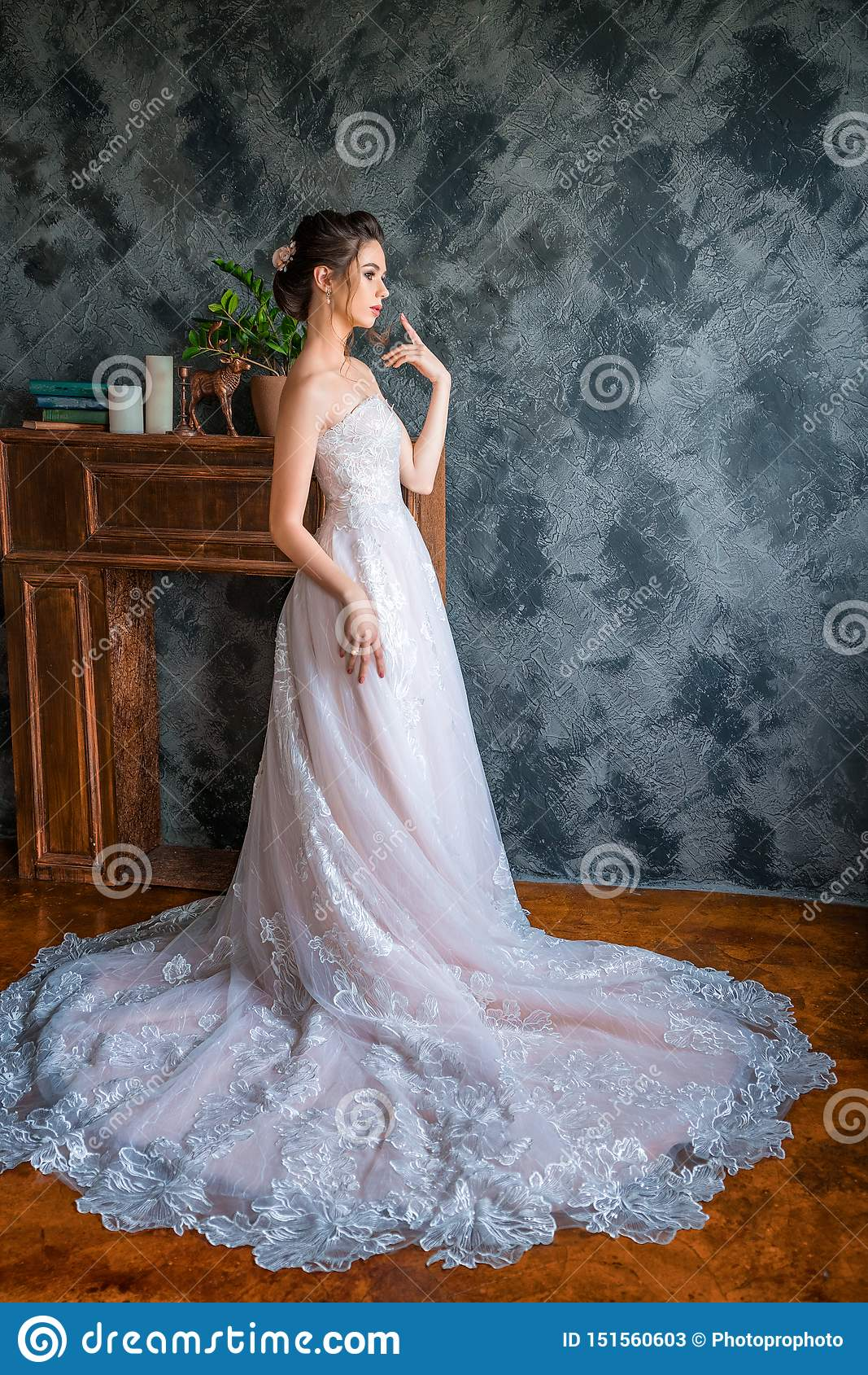 Young bride in long dress posing for the camera