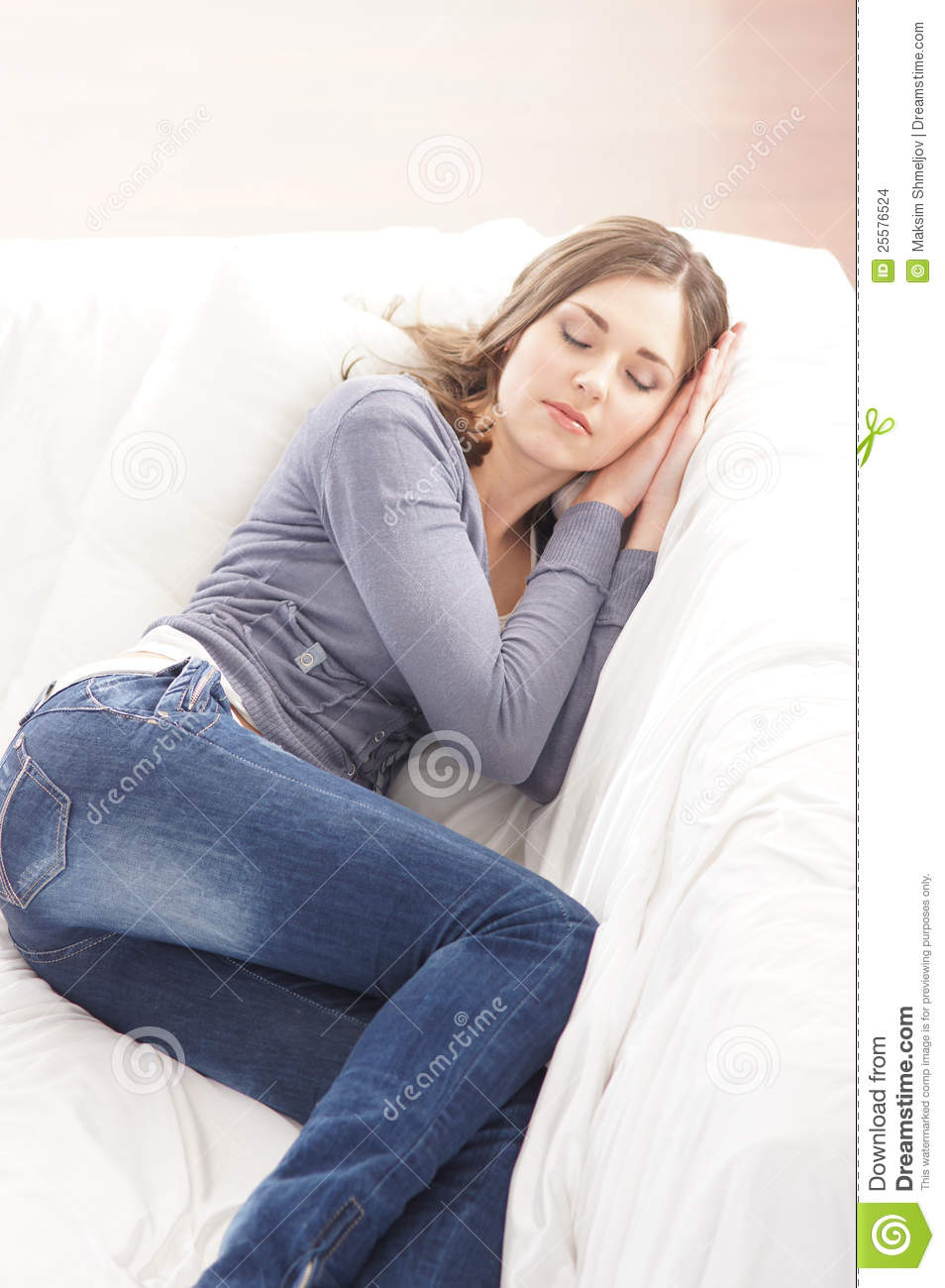 A Young Brunette Caucasian Woman Sleeping In Jeans Stock