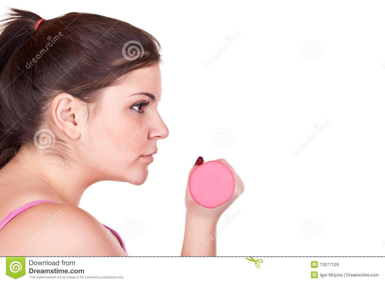 Young brunette girl holding a pink weight