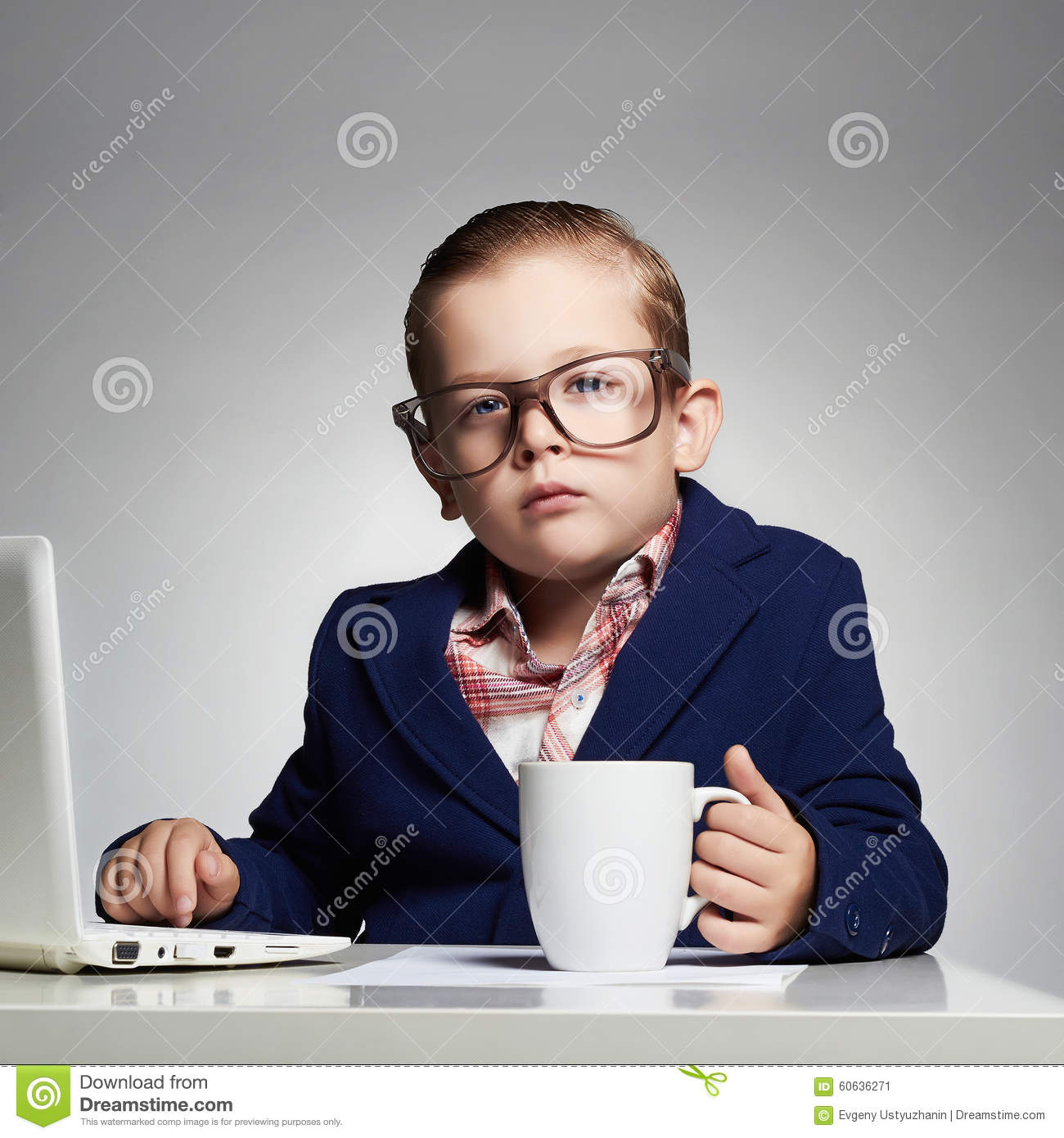 Young business boy. child in glasses. little boss in office