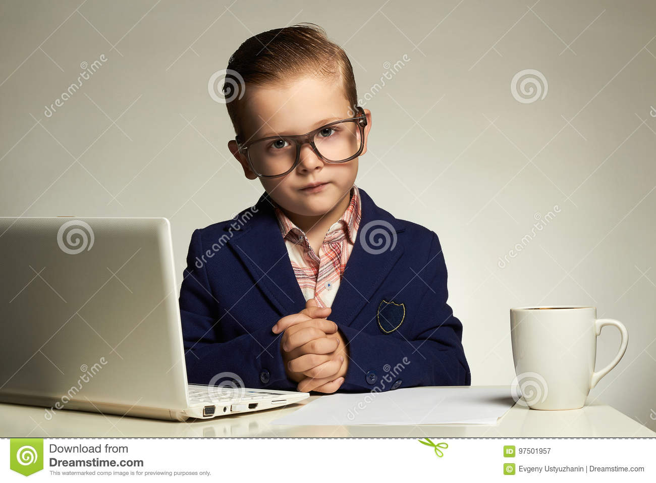 Young business boy with computer.funny child