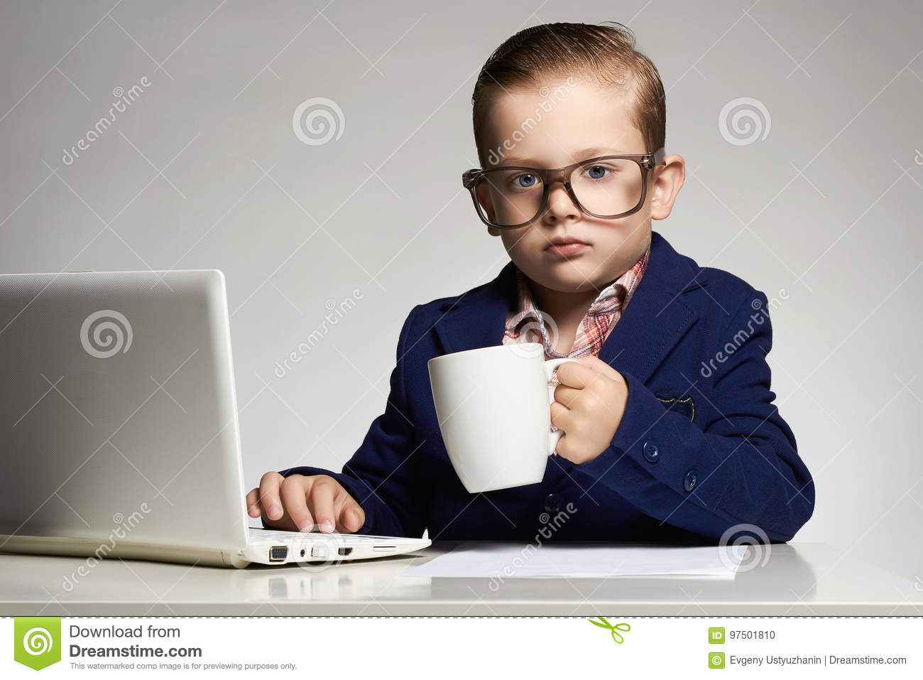 Young business child with computer