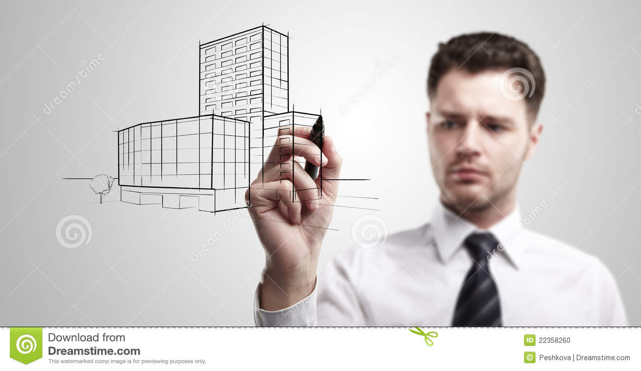 Young business man drawing a project of building