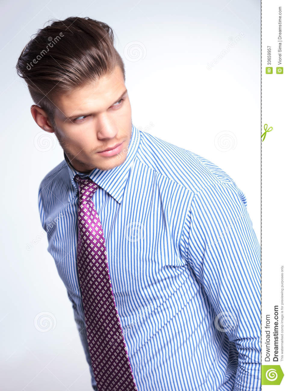 Young Business Man Looks Over His Shoulder Royalty Free