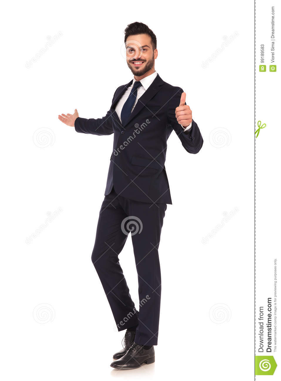 Young business man presenting and making the ok hand sign
