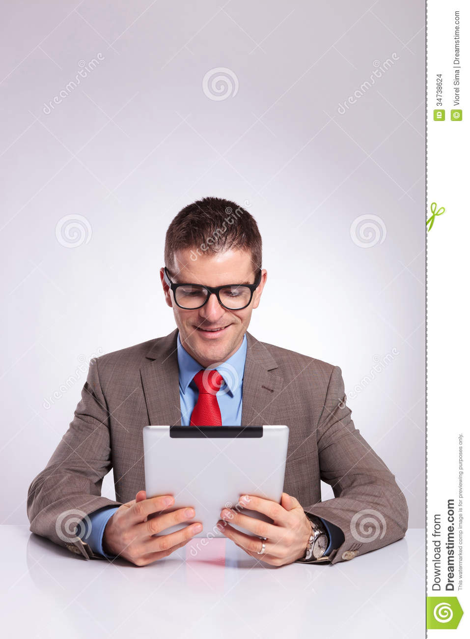 Business Man Reading Something On His Tablet Pad Royalty