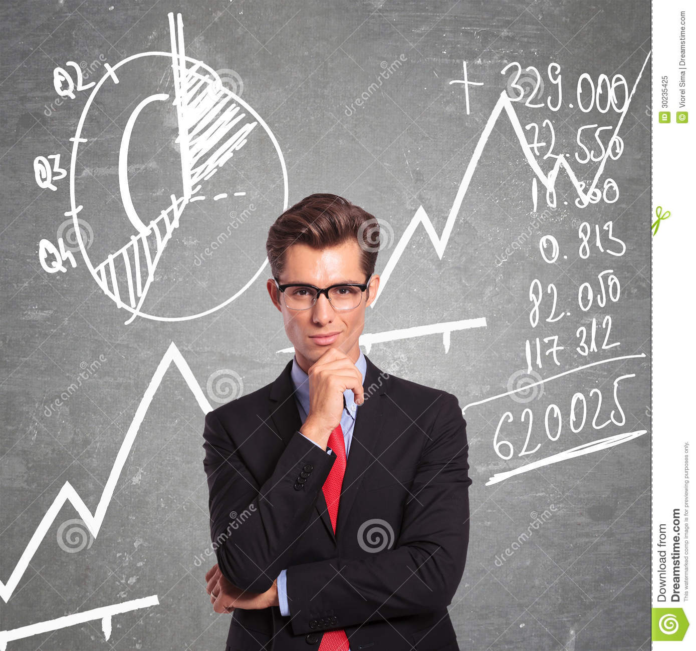 Man in front of charts