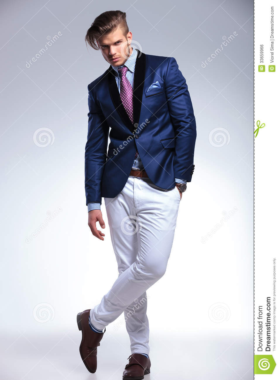 Young Business Man Stands With Crossed Feet Stock Photo