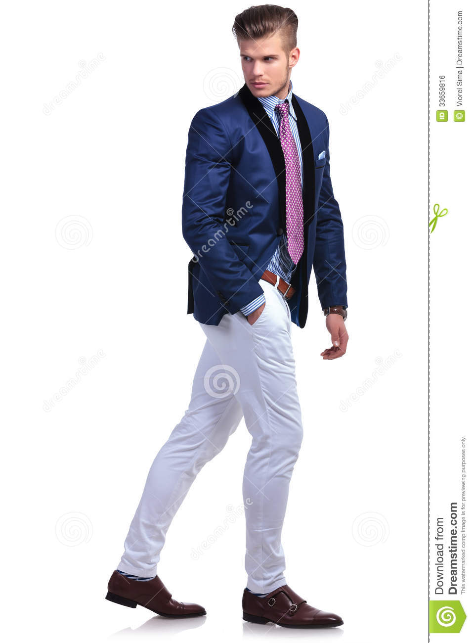 Young Business Man Walking And Looking Back Royalty Free