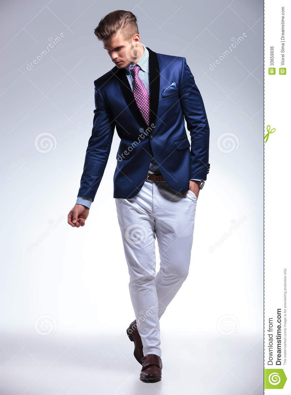 Young Business Man Walks With Hand In Pocket Royalty Free