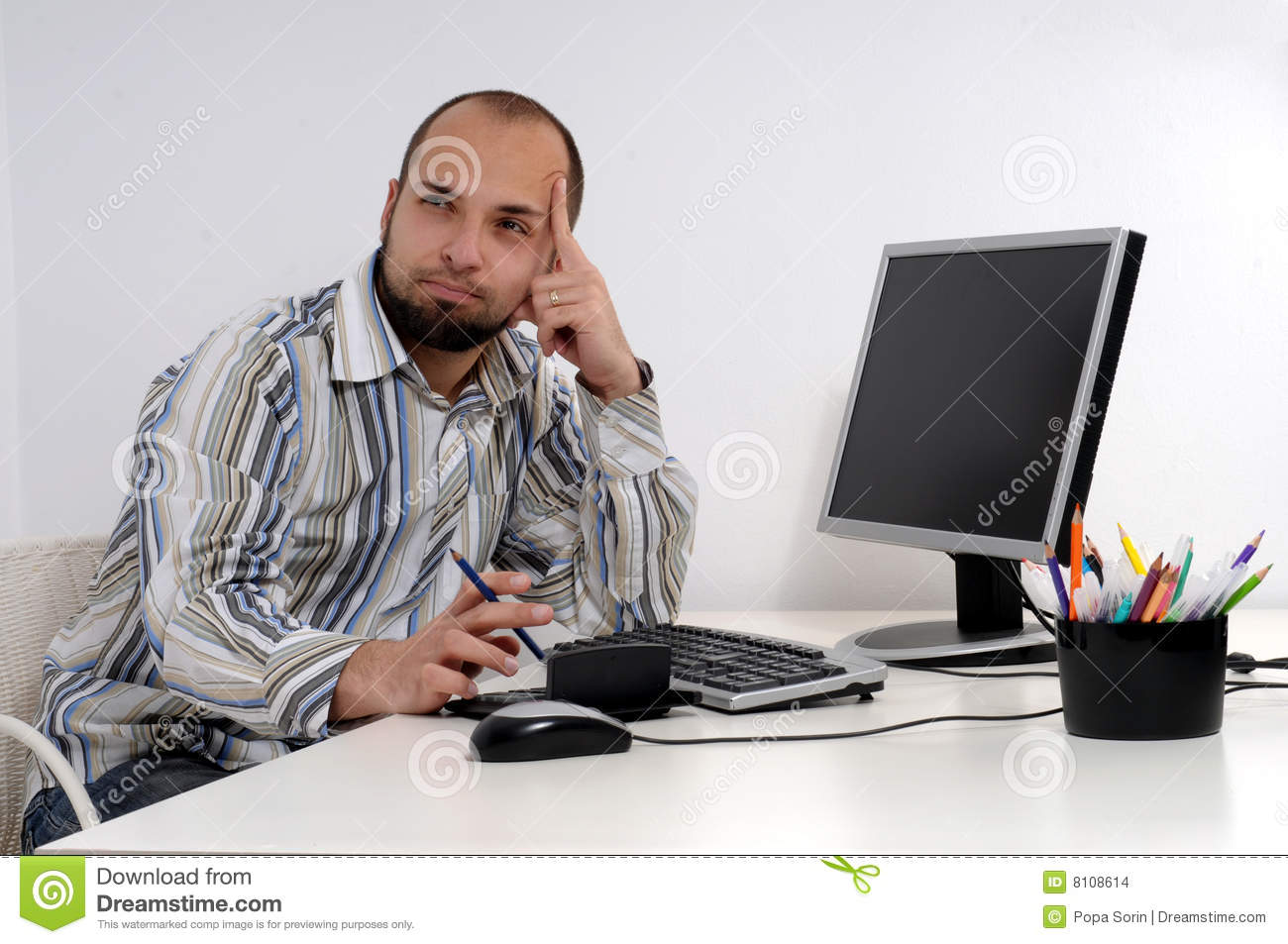 Young business man working on computer