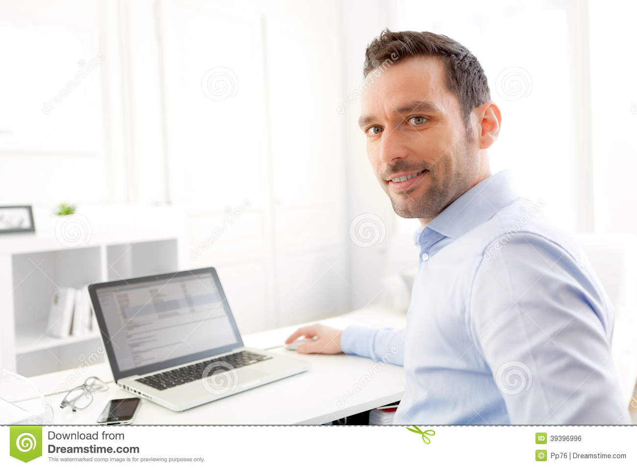 Young Business Man Working At Home On His Laptop Stock Photo - Image ...