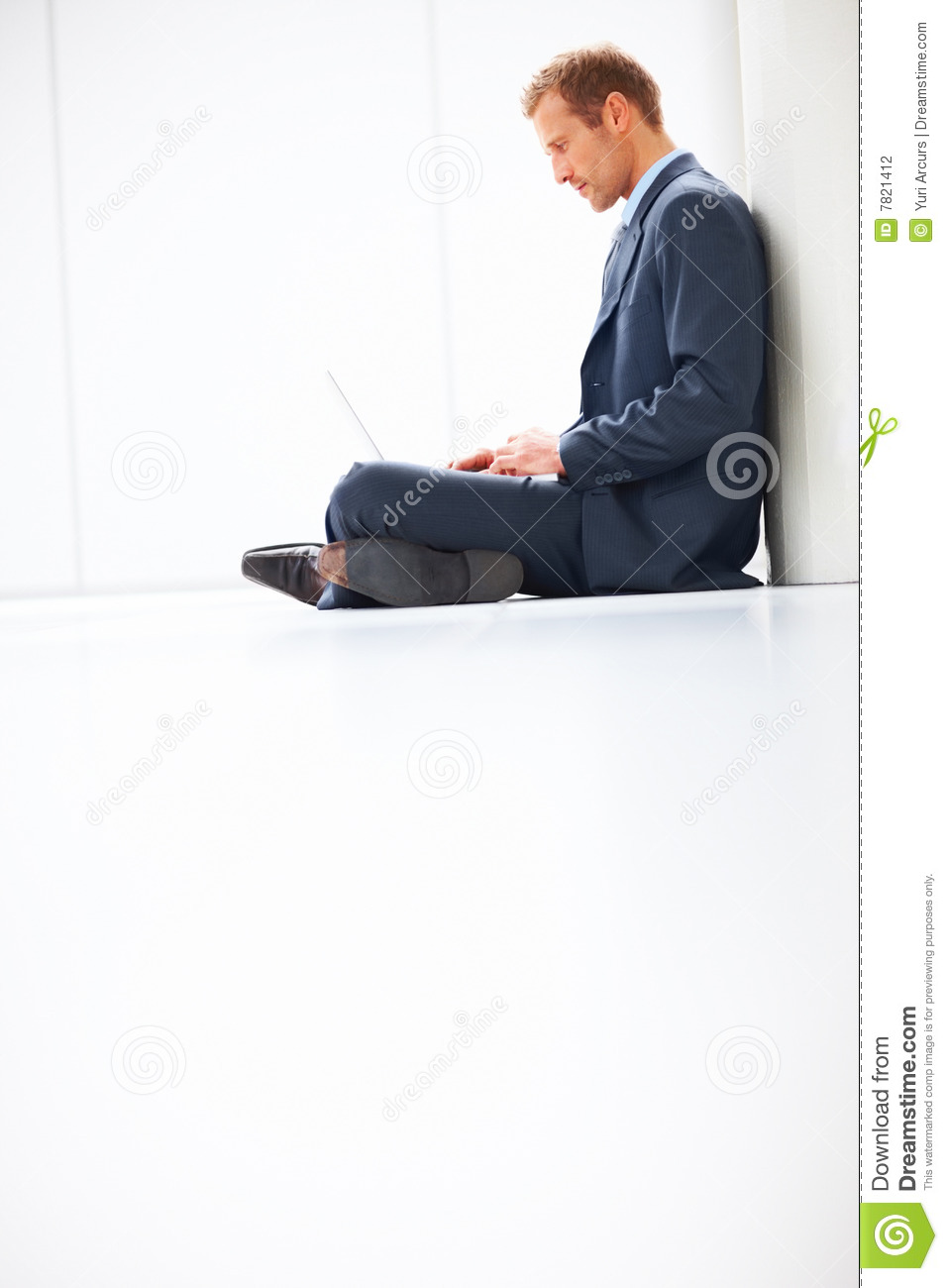 young business person sitting and using laptop stock photo