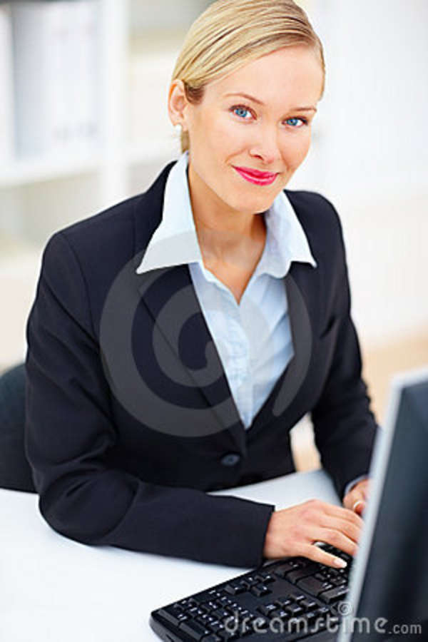stock image young business person using computer at