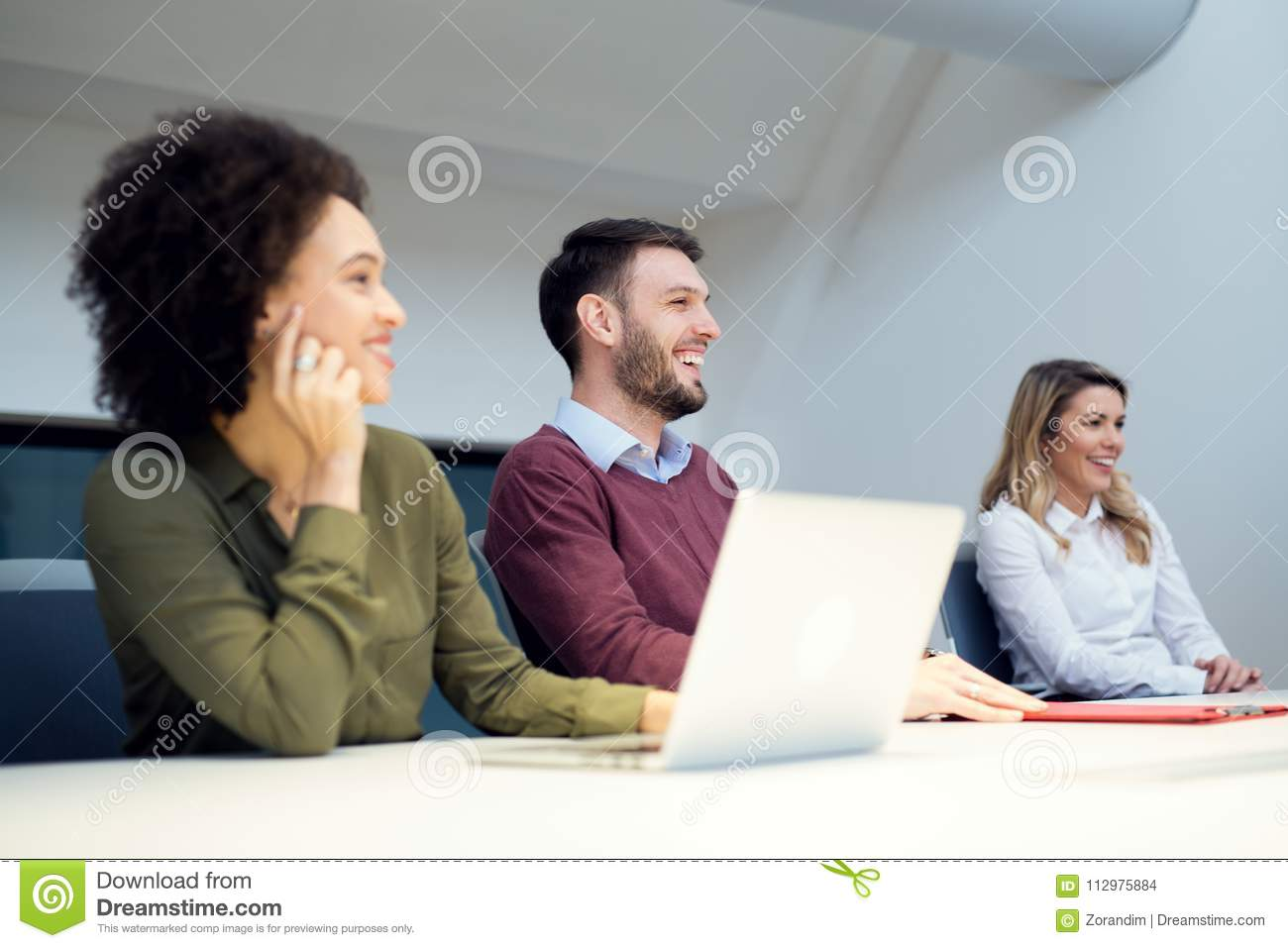 Business team in meeting, working on computer