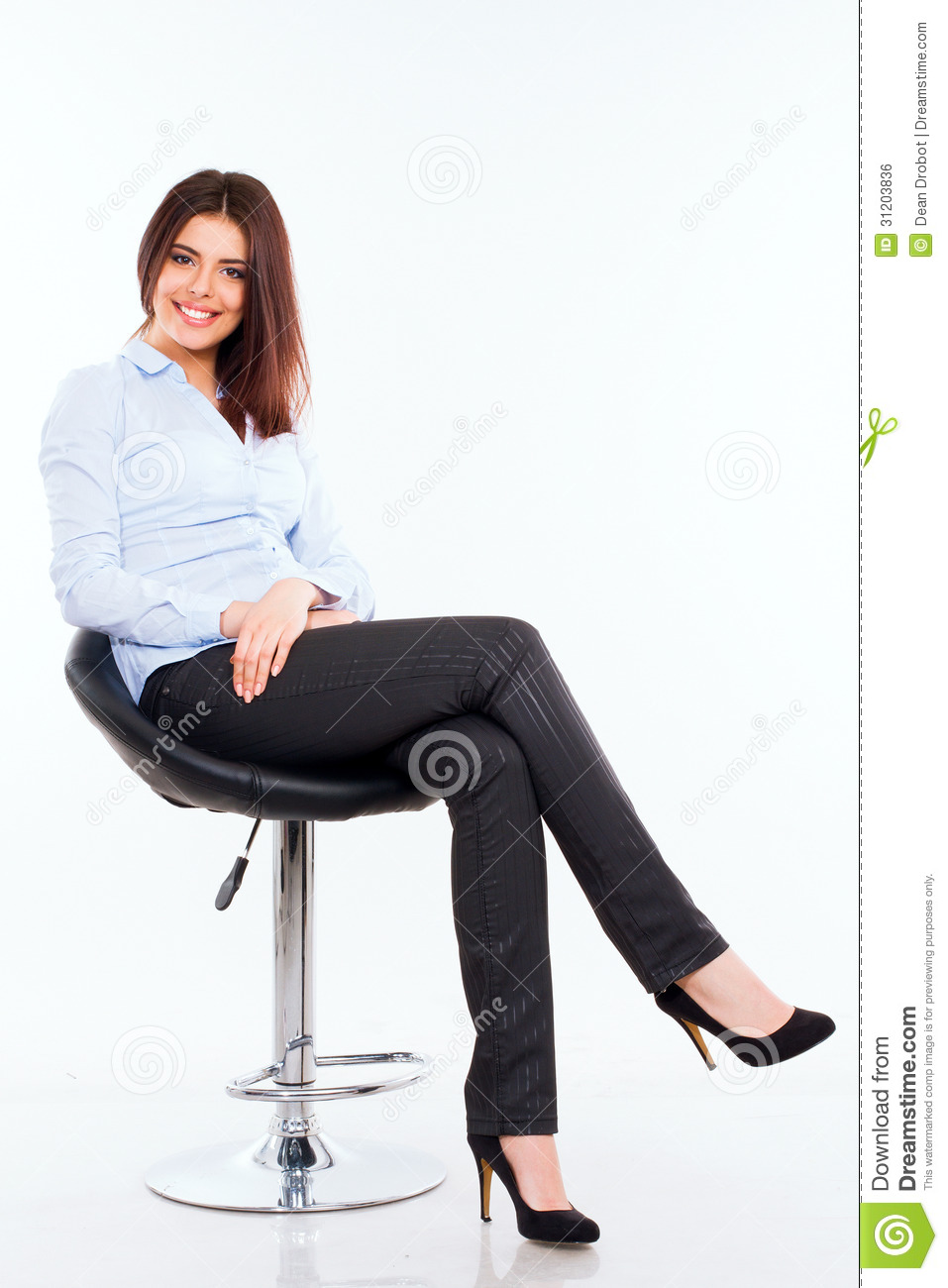 Young Business Woman In Blue Shirt Sitting On The Modern