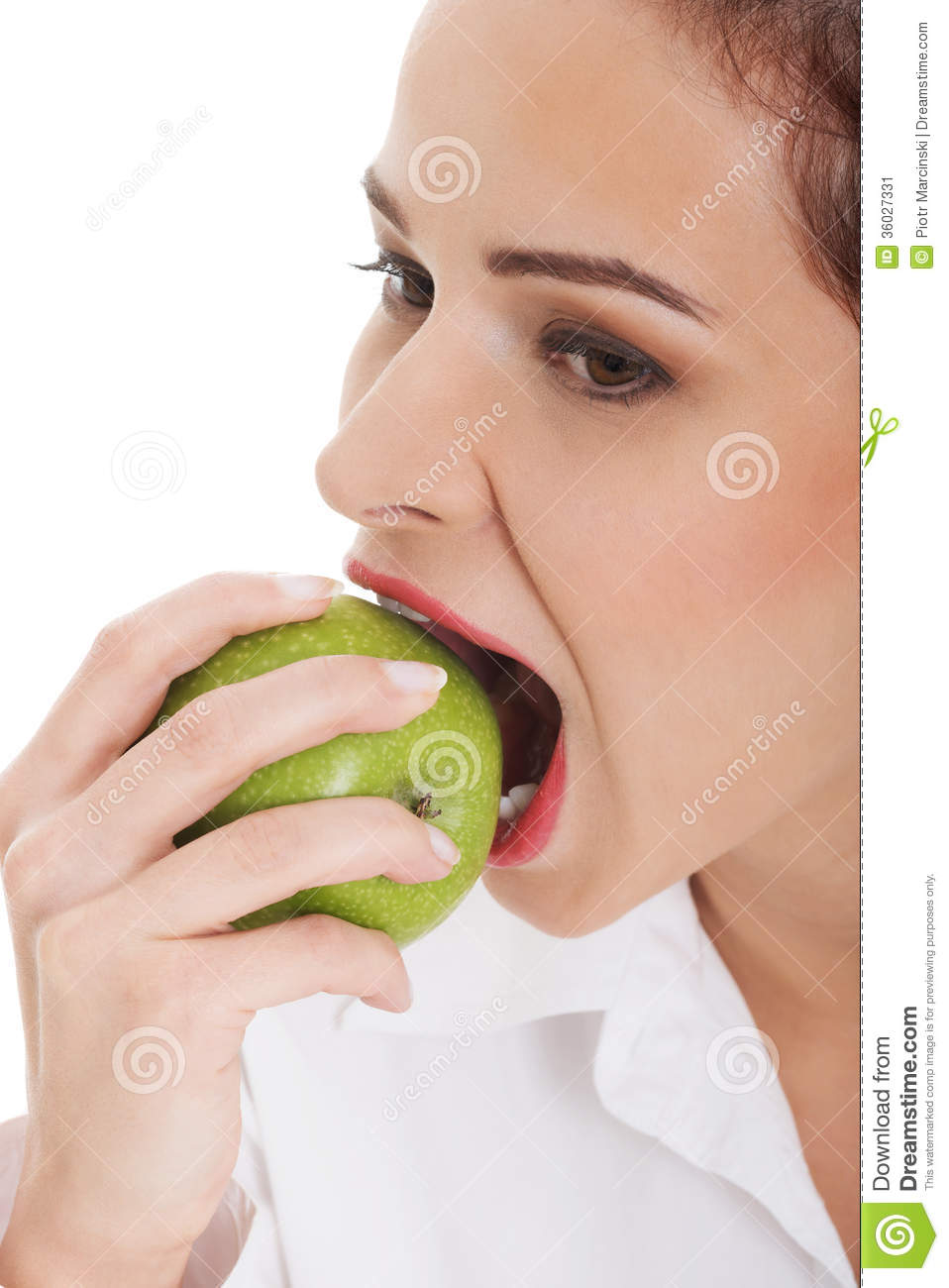 Young business woman eating apple.