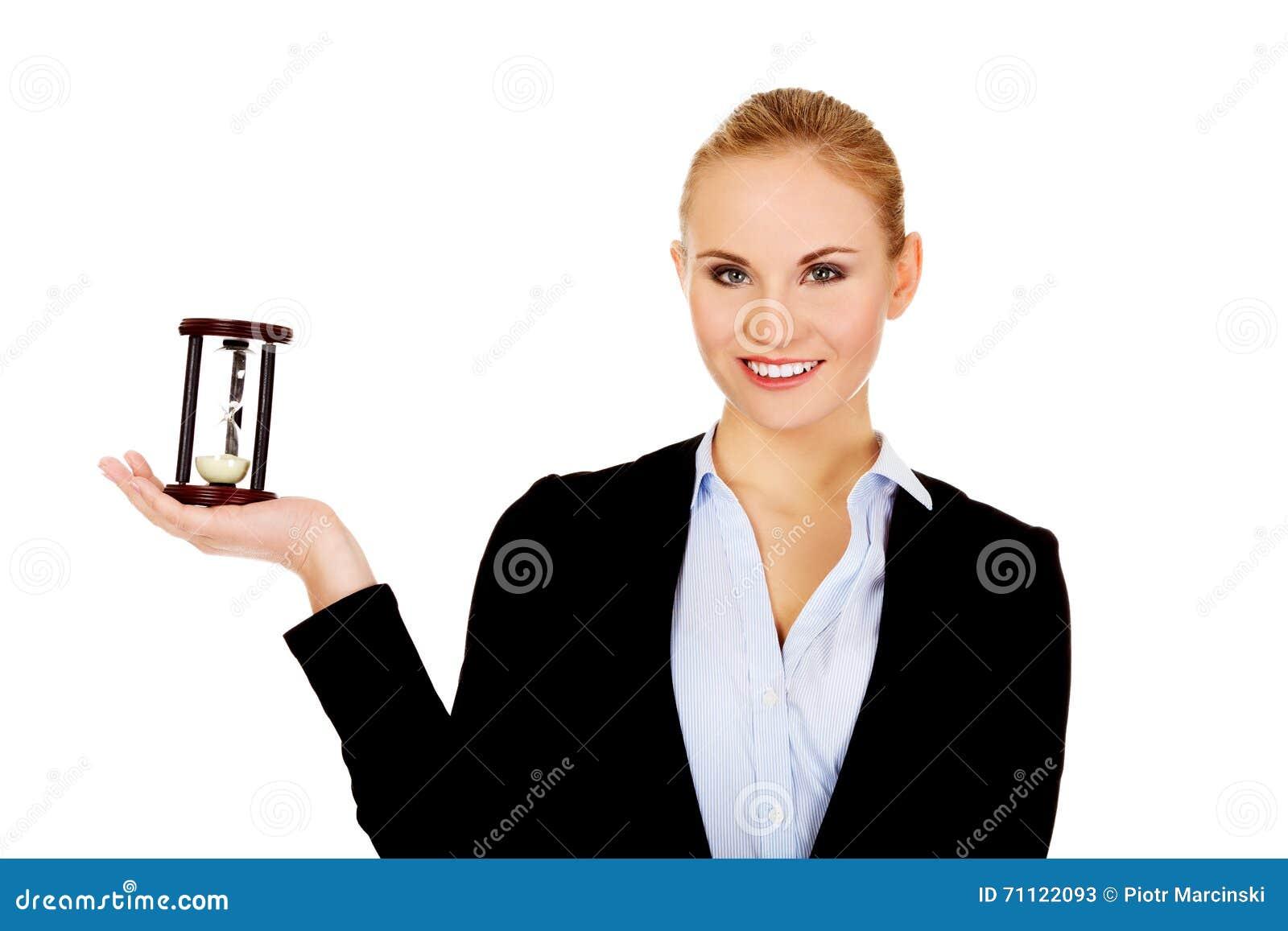 Teen Woman Holding Hourglass Stock Image - Image: 20682111