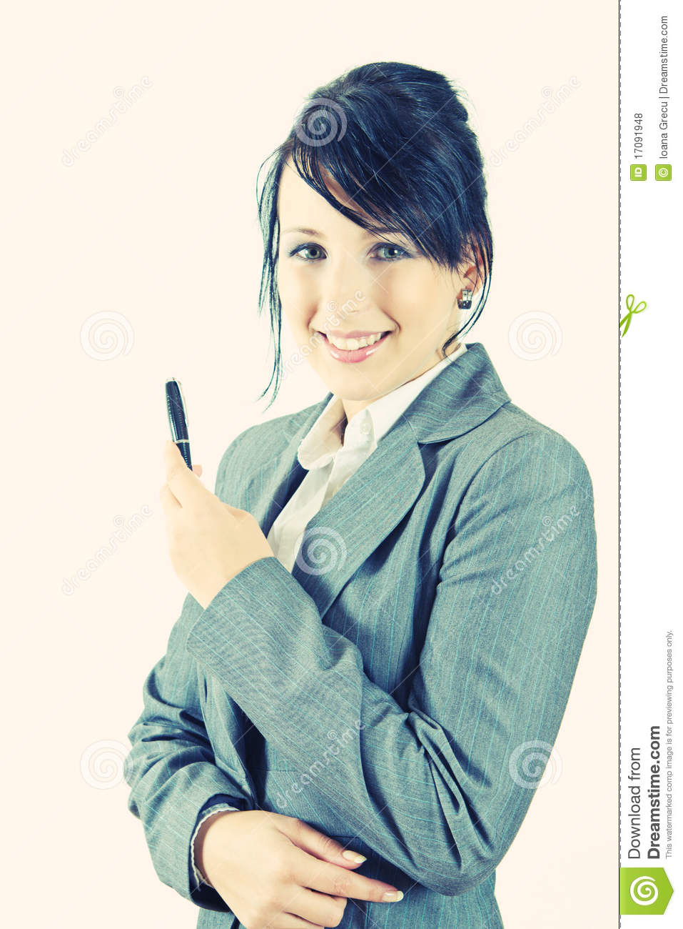 Young business woman smiling holding a pen