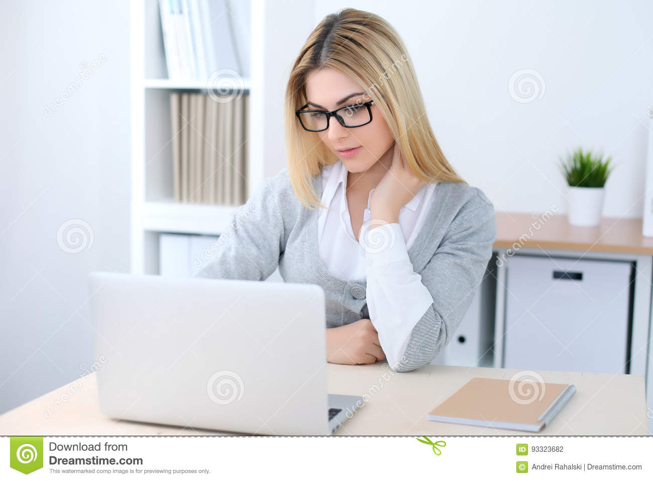 Young business woman or student girl sitting at office workplace with laptop computer. Home business concept