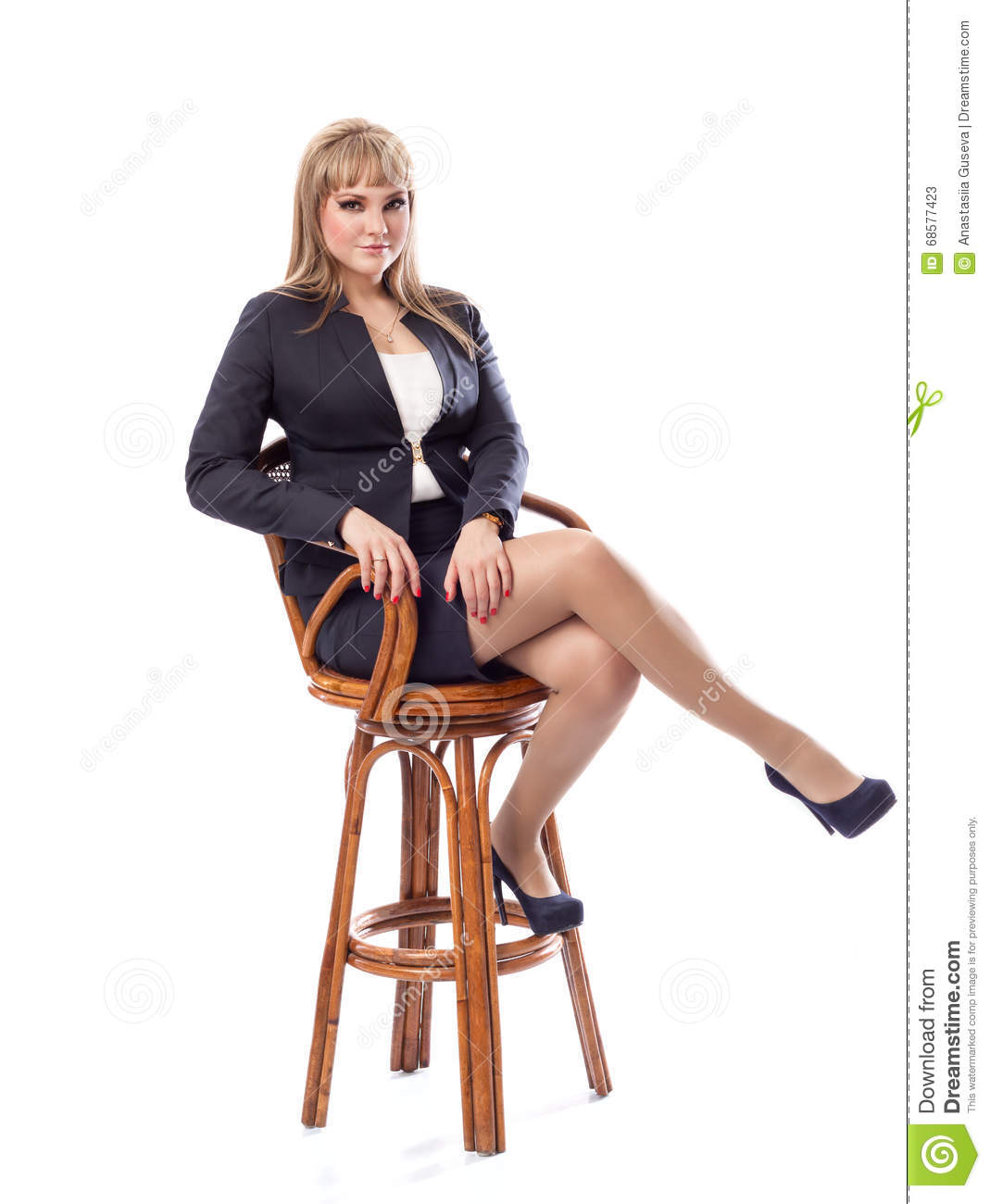 Young Business Woman In A Suit Sitting On Bar Stool