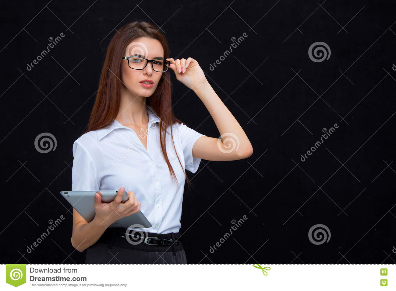 The young business woman with tablet on black background