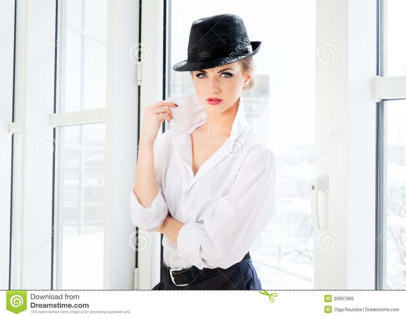 Young Business Woman Wearing Man's Shirt, Hat In Office ...