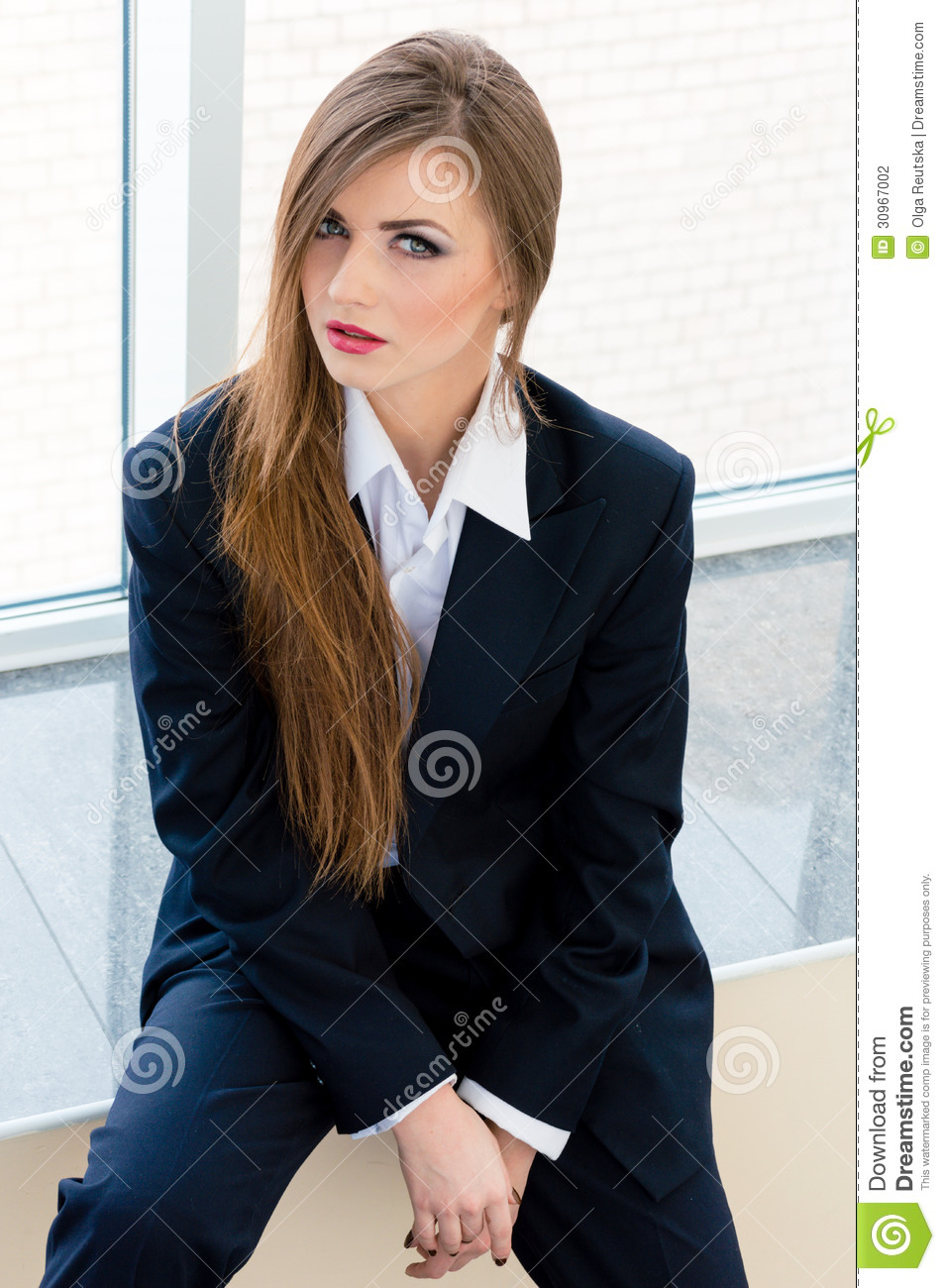 young-business-woman-wearing-man-s-suit-office-businesswoman-looking-bossy-30967002.jpg