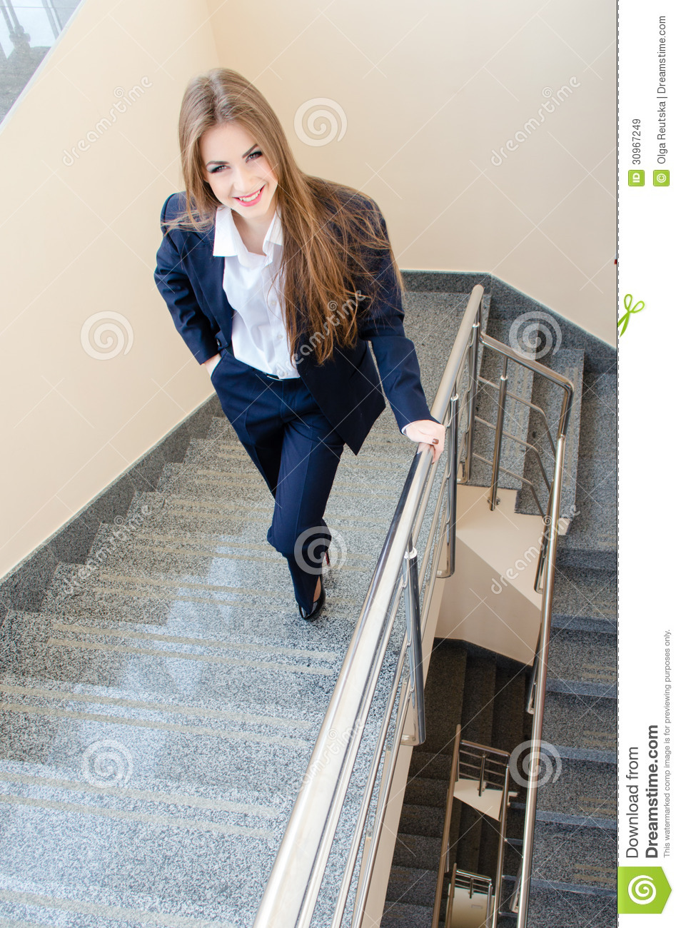 Young Business Woman Wearing Man S Suit Walking On Stairs