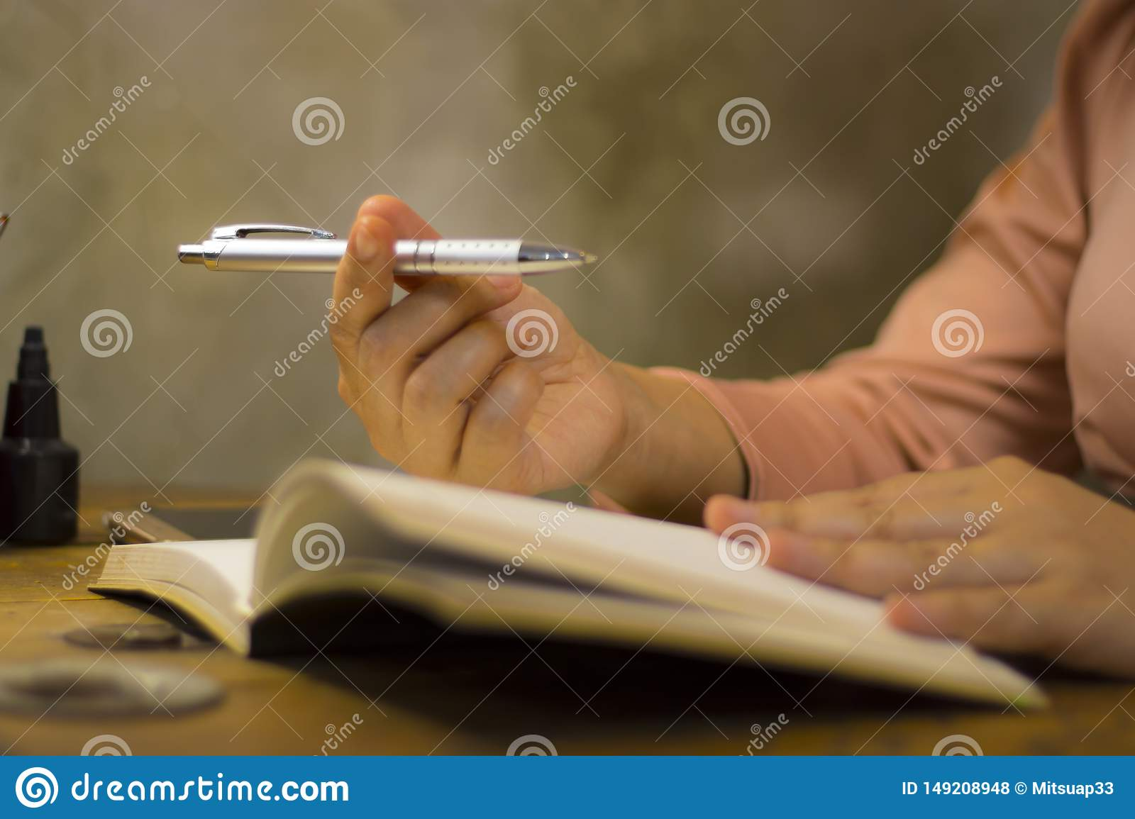 Young business woman working with a pen at office, she staying overtime