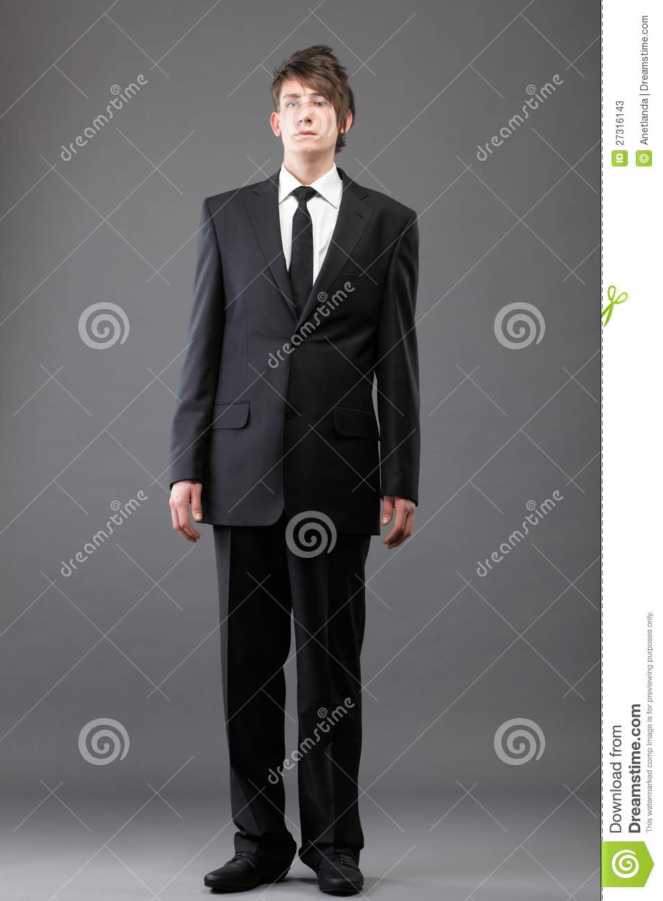 Young Businessman Black Suit Casual Tie On Gray Stock Photos ...