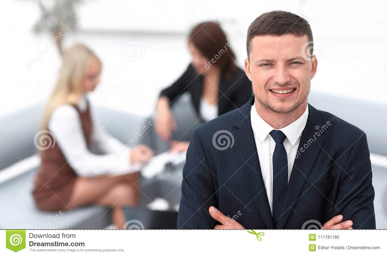 Young businessman on blurred background office.
