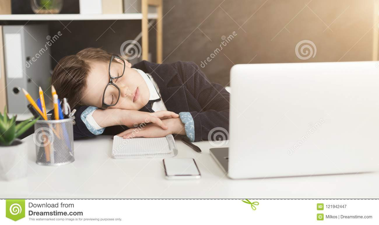 Young businessman child in business suit get tired and fell asleep